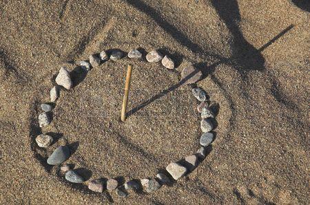 2110232-sundial-on-sea-sand