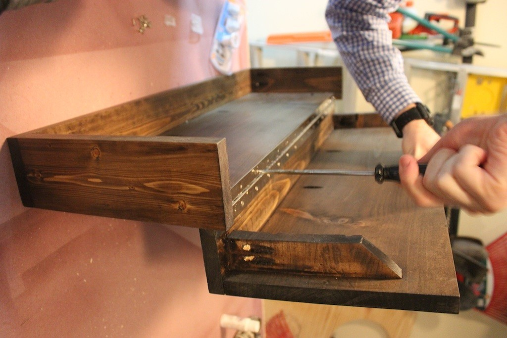 A piano hinge turns this diy shelf into something much for Concealed piano hinge